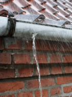 Damaged leaking gutter
